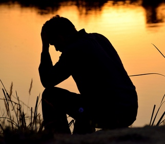 Trauma impacts pet loss and grief support. Image of man in trauma
