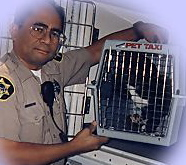 Trauma impacts pet loss and grief support. Image of humane Officer and shelter animal
