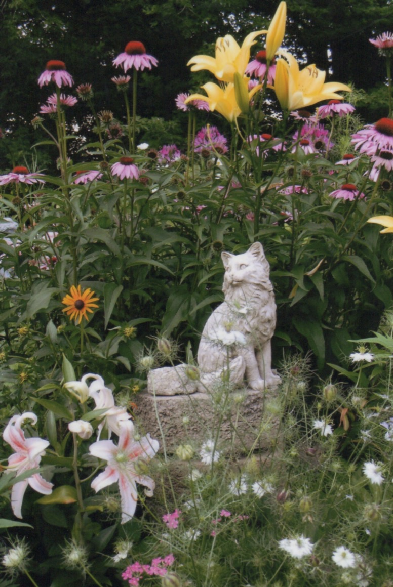 Animal Euthanasia Class-Cat statue in beautiful garden