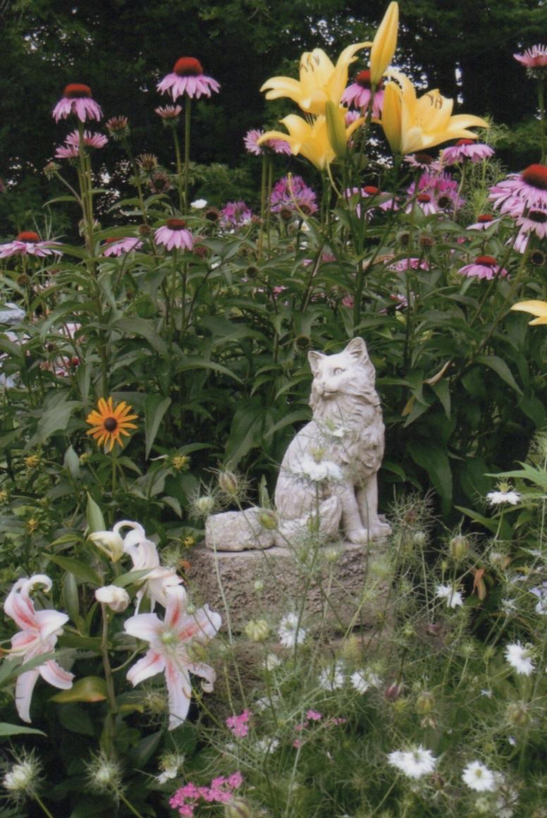 Animal Euthanasia Class-Cat statue in beautiful garden