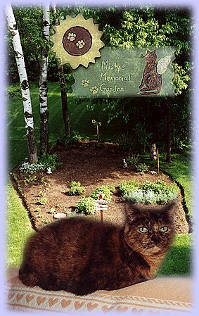 Memorial Garden sign and cat